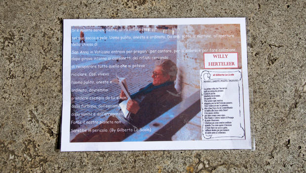 A laminated picture is seen on the grave of Willy Herteleer, a homeless man buried in the Teutonic Cemetery at the Vatican, Feb. 27, 2015.