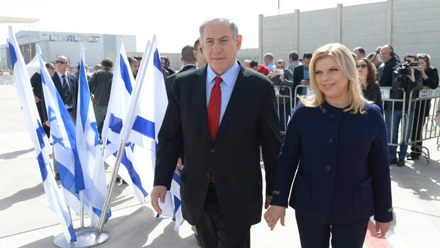 In this handout provided by the Israeli Government Press Office, Prime Minister Benjamin Netanyahu and his wife Sarah leave Tel Aviv
