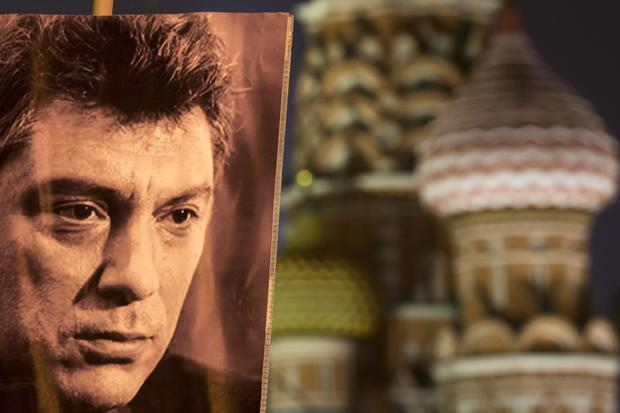 A portrait of Russian opposition leader Boris Nemtsov, and sharp critic of President Vladimir Putin, who was gunned down Feb. 27, 2015 near the Kremlin, seen at right with St. Basil's Cathedral in the background in Moscow