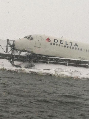 Plane skids off runway at LaGuardia