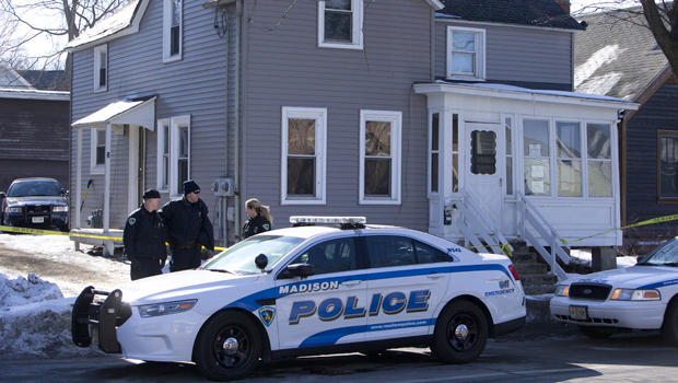 Madison Police investigate the scene of a police-involved shooting at a home in Madison, Wis., March 7, 2015.