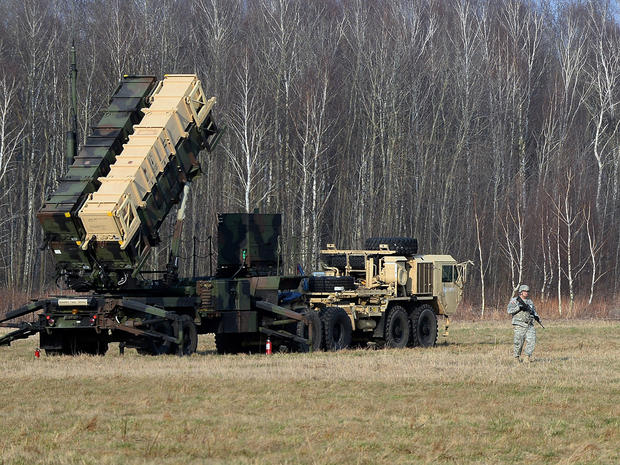 U.S. troops place a Patriot air and missile defense launching system at a test range in Sochaczew, Poland