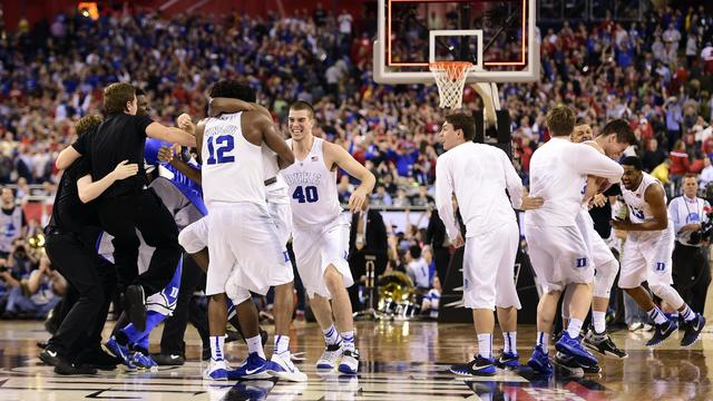 Duke Blue Devils celebrate after defeating Wisconsin Badgers, 68-63, in 2015 NCAA Men's Division I Championship game at Lucas Oil Stadium in Indianapolis on April 6, 2015