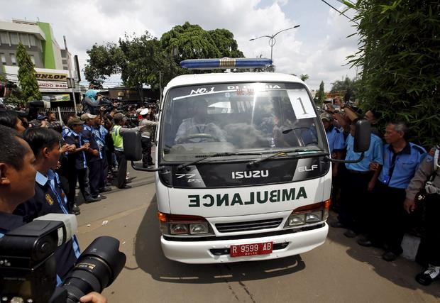 An ambulance carrying one of the bodies of two Australians who were executed earlier arrives at a funeral home in Jakarta