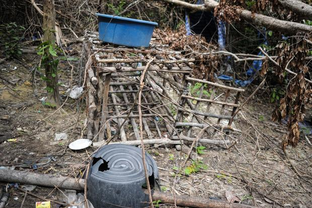 A small cage is seen at an abandoned migrant camp used by human traffickers in a jungle at Bukit Wang Burma in the Malaysian northern state of Perlis, which borders Thailand
