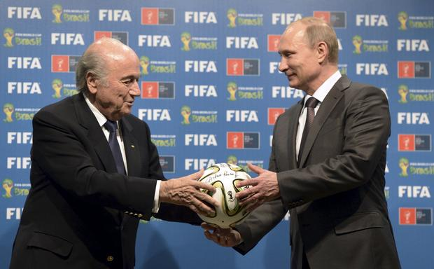 Russia's President Vladimir Putin and FIFA President Sepp Blatter take part in the official handover ceremony for the 2018 World Cup in Rio de Janeiro