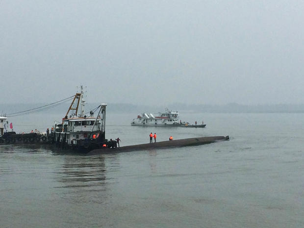 Rescue workers search on a sunken ship in the Jianli section of Yangtze River, Hubei province, China