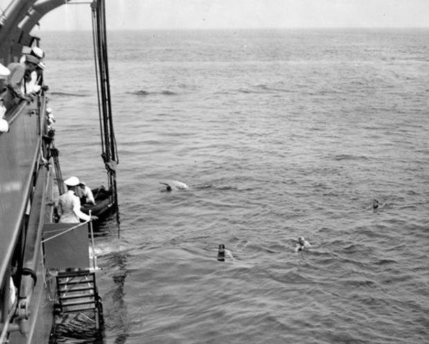 truman-swimming-with-usss-agents.jpg