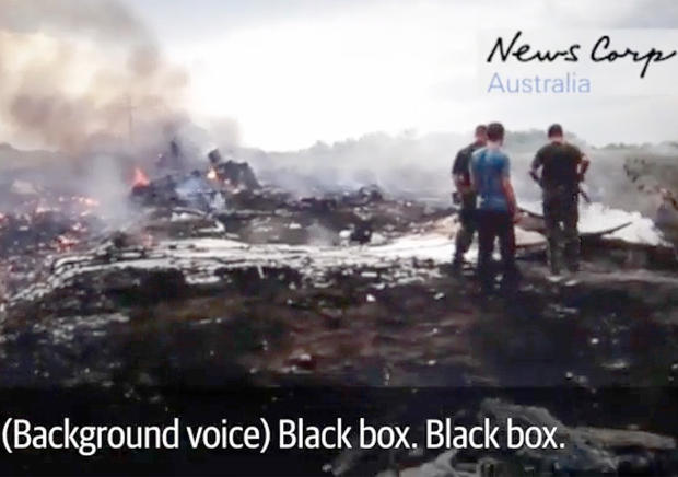 Video obtained by News Corp Australia shows pro-Russian rebels at the scene of the Malaysia Airlines Flight 17 crash in Hrabove, eastern Ukraine, soon after it was brought down by a missile, July 17, 2014.