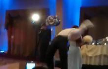 Backflipping groom knocks out bridesmaid