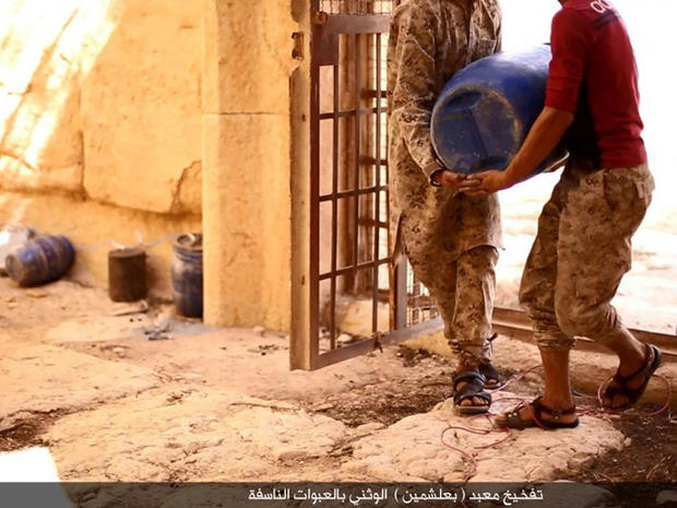 An image posted online by ISIS' branch in the Syrian province of Homs appears to show  militants planting explosives inside the ancient temple of Baalshamin