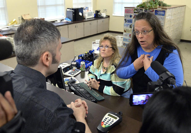 Rowan County Clerk Kim Davis, right, talks with David Moore following her office's refusal to issue marriage licenses at the Rowan County Courthouse in Morehead, Ky., Sept. 1, 2015.