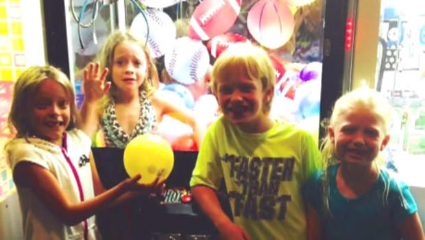 Juliette Grimes, 6, is seen trapped inside an arcade game at her local pizza parlor.