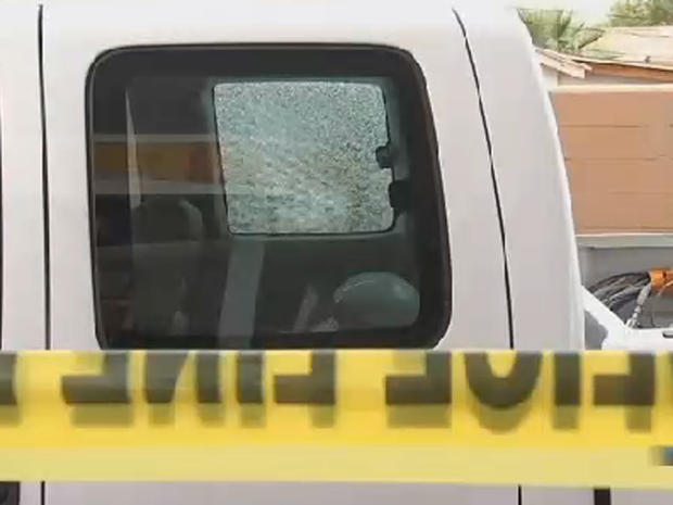 Pickup truck's shattered window is seen on September 9, 2015 after what may have been latest in string of windows being shot out while vehicles were travelling on Phoenix area highways