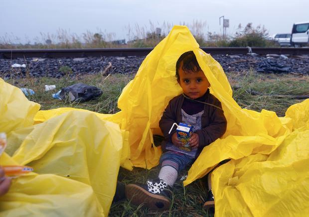 migrantboyrainhungary.jpg