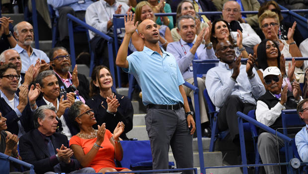 Former tennis player James Blake acknowledges the crowd during the match between Roger Federer of Switzerland and Stan Wawrinka of Switzerland on day 12 of the 2015 U.S. Open tennis tournament at USTA Billie Jean King National Tennis Center in New York.
