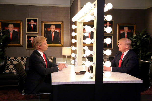 """In this image released by NBC, host Jimmy Fallon, left, and Republican presidential candidate Donald Trump appear in the """"Trump in the Mirror"""" skit during a taping of """"The Tonight Show"""" Sept. 11, 2015, in New York."""