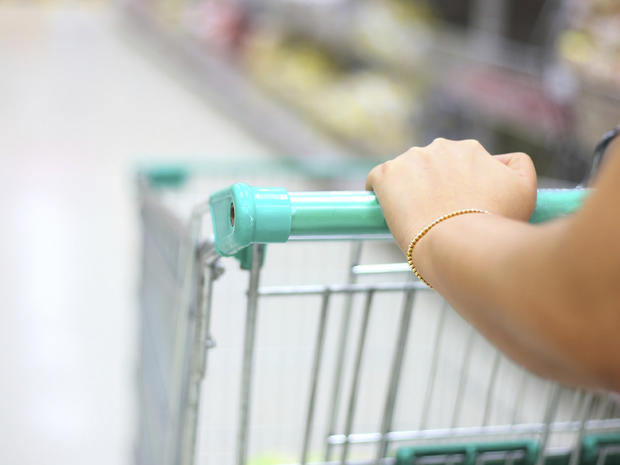 woman hand with shopping cart in supermarket