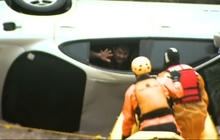 Watch: Man rescued from flooded car