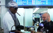 Dennis Rodman returns from North Korea