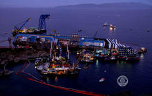 Crews begin slow, difficult task of righting Costa Concordia