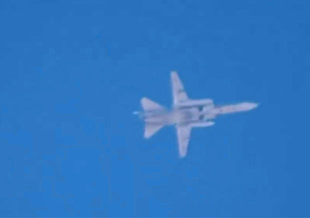 A fighter jet believed to be Russian is seen flying over Latamneh, in the northern Syrian governate of Hama, Sept. 30, 2015, in video posted online by anti-government activists.