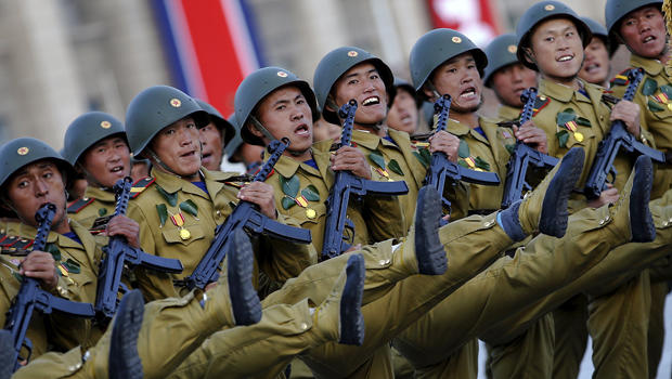 Soldiers shout slogans as they march past a stand with North Korean leader Kim Jong Un during the parade celebrating the 70th anniversary of the founding of the ruling Workers' Party of Korea in Pyongyang Oct. 10, 2015.