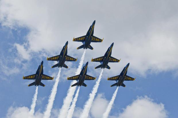 16-boeing-100-years-fa18-hornet-blue-angels-delta-formation.jpg