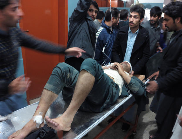 A patient is brought to a hospital after a severe earthquake was felt in Mingora, the main town of Pakistan Swat valley