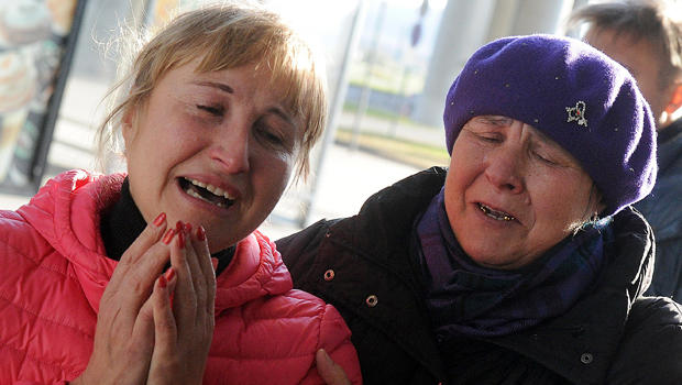 Relatives react at Pulkovo international airport outside St. Petersburg after a Russian plane with 224 people on board crashed in a mountainous part of Egypt's Sinai Peninsula Oct. 31, 2015.