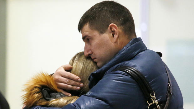 Relatives react after a Russian airliner with 217 passengers and seven crew aboard crashed as people gather at Russian airline Kogalymavia's information desk at Pulkovo airport in St. Petersburg, Russia, Oct. 31, 2015.