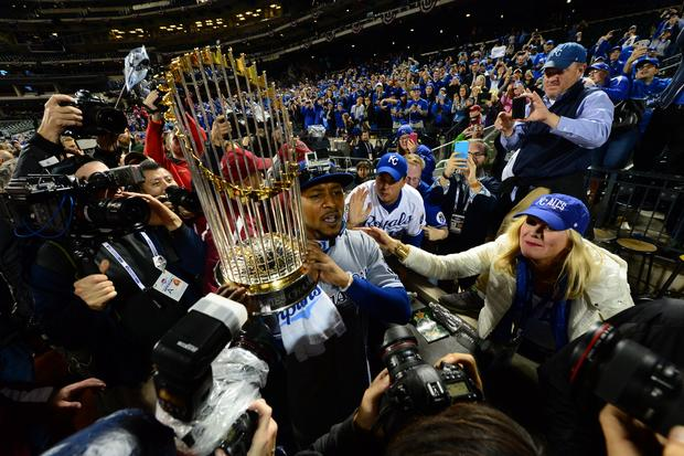 Kansas City Royals center fielder Jarrod Dyson hoists Commissioners Trophy after Royals defeated New York Mets in game 5 of the World Series at Citi Field in New York to win the Series, four-games-to-one