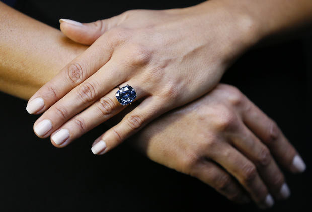 "The rare ""Blue Moon"" Diamond is displayed at Sotheby's auction rooms in London Sept. 17, 2015."