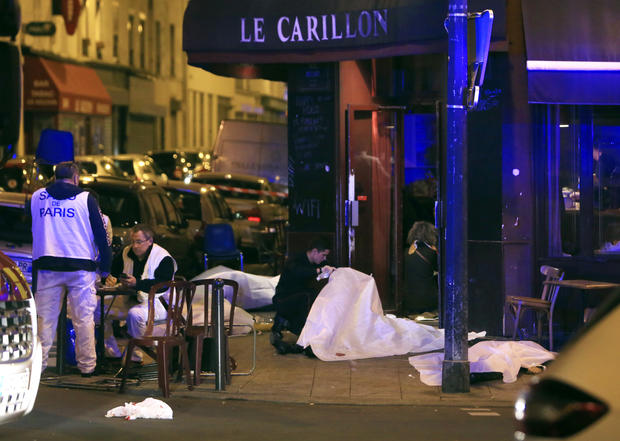 Victims lay on the pavement in a Paris restaurant Nov. 13, 2015. Police officials in France reported a shootout in a Paris restaurant and an explosion in a bar near a Paris stadium.