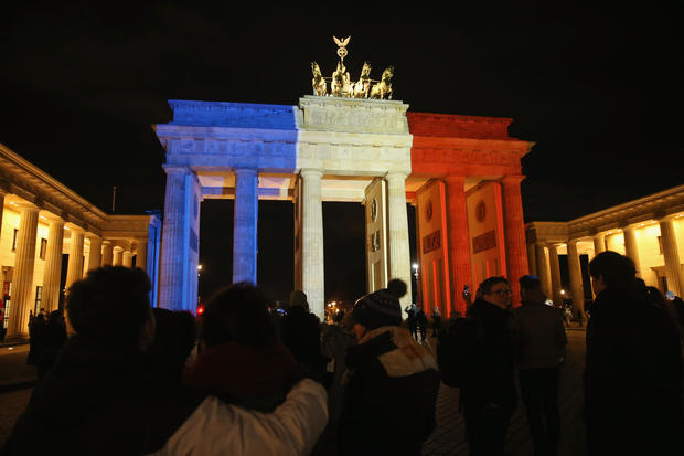 Landmarks light up in solidarity with France