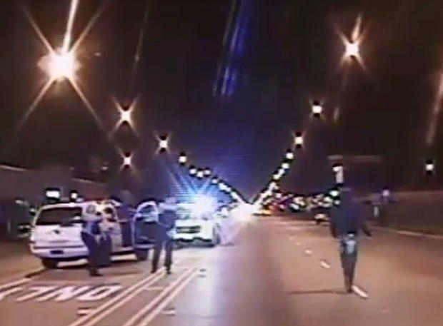 Laquan McDonald, right, walks on a road before he was shot 16 times by police officer Jason Van Dyke in Chicago in this still image taken from a police vehicle dash camera video shot on Oct. 20, 2014, and released by Chicago police on Nov. 24, 2015.