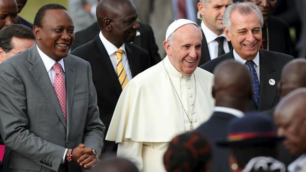 Pope Francis smiles as he walks next to Kenyan President Uhuru Kenyatta, left, in Nairobi, Kenya, Nov. 25, 2015.
