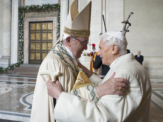 Pope Francis (L) embraces Emeritus Pope Benedict XVI before opening the Holy Door to mark opening of the Catholic Holy Year, or Jubilee, in St. Peter's Basilica