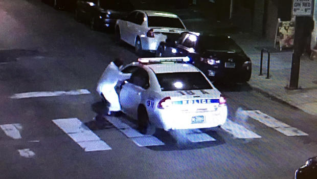A gunman takes aim at a Philadelphia police officer Jan. 7, 2016, in a still taken from police camera footage.