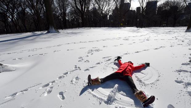 "Tara Jakeway with ""Chasing News"" makes a snow angel in the man-made snow in Central Park Jan. 20, 2016, as part of Winter Jam NYC's Ultimate Snow Day."
