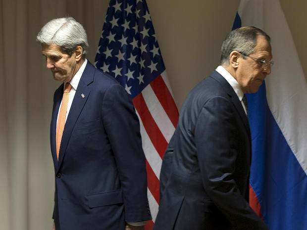 U.S. Secretary of State John Kerry and Russian Foreign Minister Sergey Lavrov walk to their seats for a meeting about Syria in Zurich, Switzerland, Jan. 20, 2016.