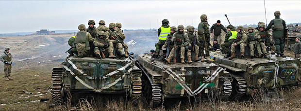 """A U.S. military trainer moves out of the way as a platoon of Ukrainian soldiers prepare for """"live fire"""" exercises at a training center near Ukraine's border with Poland, in late January, 2016."""