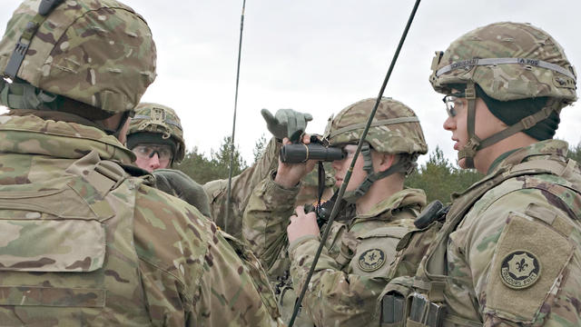 U.S. and Latvian soldiers observe a mortar training exercise at a base in Ādaži, Latvia