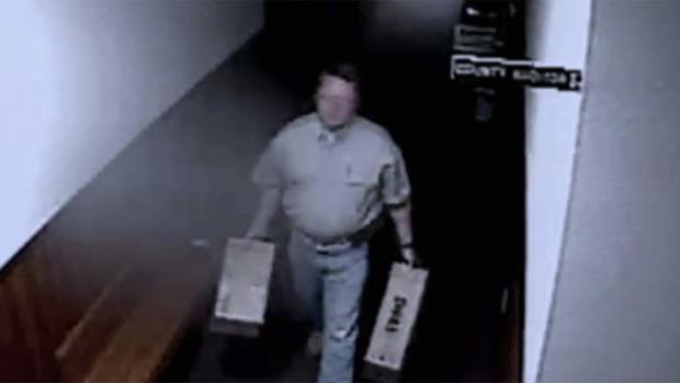 Eric Williams shown on surveillance video with computer equipment
