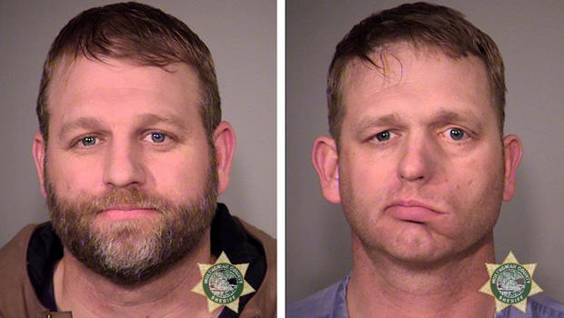 Ammon Bundy, left, and his brother, Ryan Bundy, are seen in a combination of police jail booking photos released by the Multnomah County Sheriff's Office in Portland, Oregon, Jan. 27, 2016.