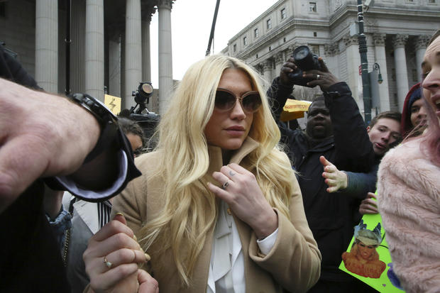 Pop star Kesha leaves Supreme Court in New York on Feb. 19, 2016 after losing bid to be freed from recording contract with Dr. Luke