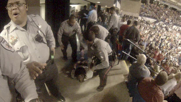 Rakeem Jones lies on the ground while being removed by deputies from a Donald Trump rally in Fayetteville, North Carolina, March 9, 2016, in a still image from video provided by Ronnie Rouse March 10, 2016.