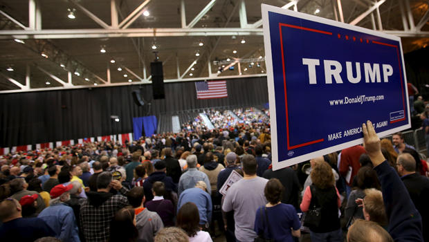 Supporters wait for the arrival of Republican presidential candidate Donald Trump at a campaign rally in Cleveland, Ohio, March 12, 2016.