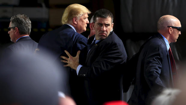Secret Service agents surround Republican presidential candidate Donald Trump during a disturbance as he speaks at Dayton International Airport in Dayton, Ohio, March 12, 2016.