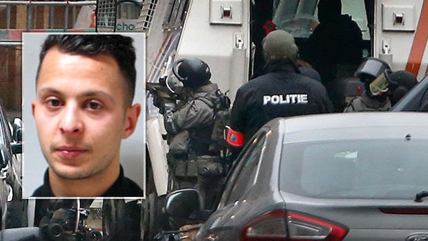 Police are seen at the scene of a security operation where Salah Abdeslam, inset, was arrested in the Brussels suburb of Molenbeek in Brussels, Belgium, March 18, 2016.